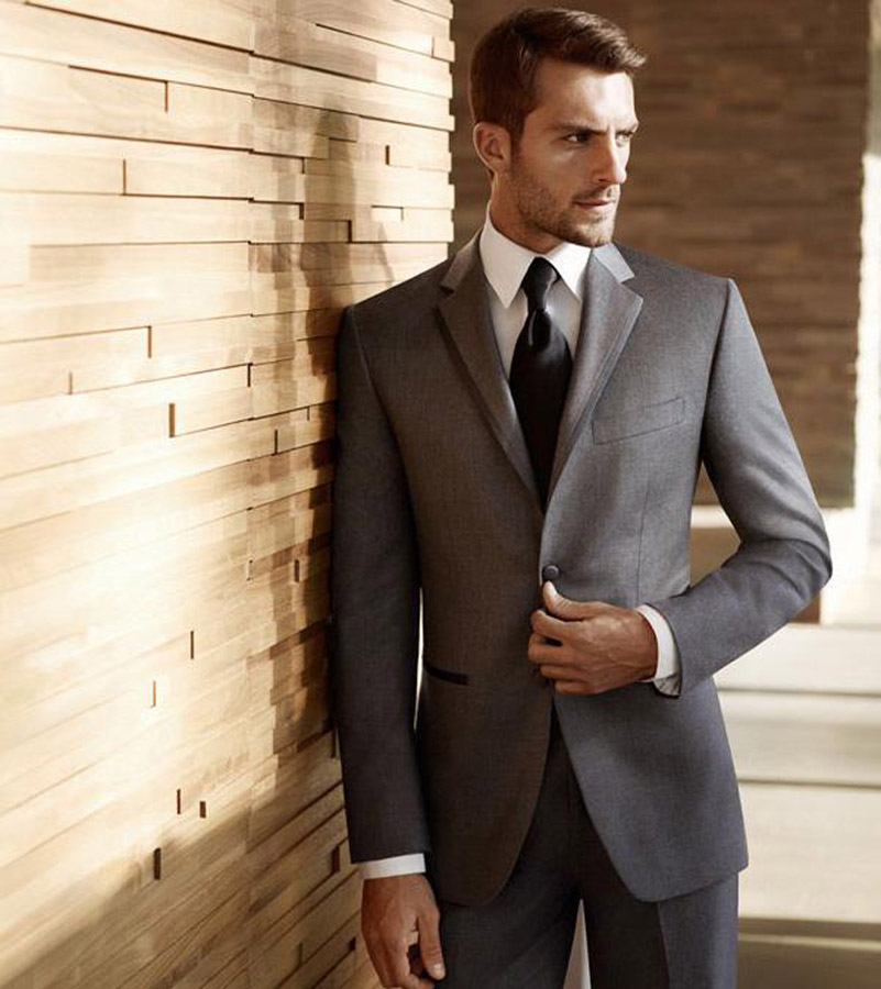 man-wearing-suit-four-in-hand-knot